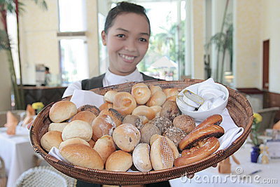 Waiter and Breads at restaurant