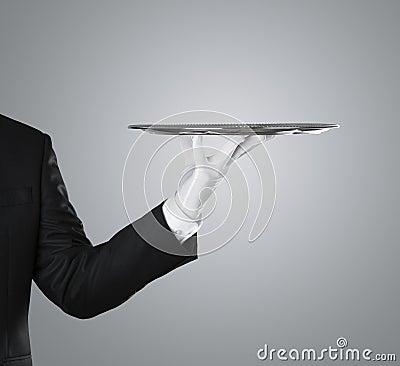 Waiter holding empty silver tray