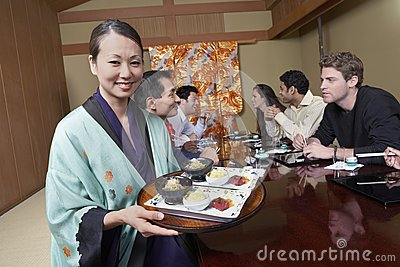 Waiter Holding Plates To Serve Food