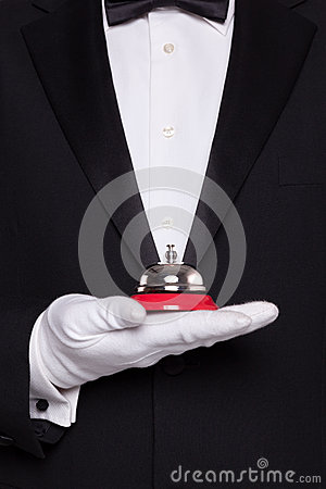 Waiter holding a service bell.