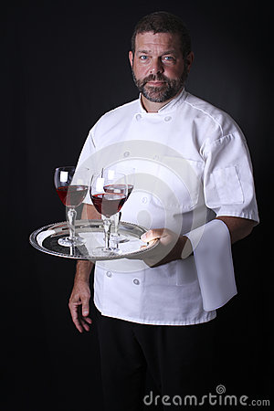 A waiter holding a tray of wine glasses.