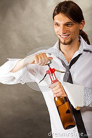Waiter opens wine bottle. Stock Photo