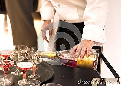 Waiter pooring champagne