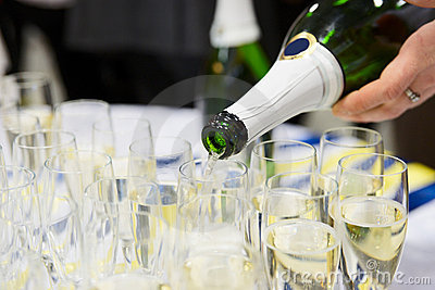 Waiter is pouring champagne