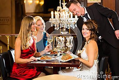 Waiter served dinner in a fine restaurant