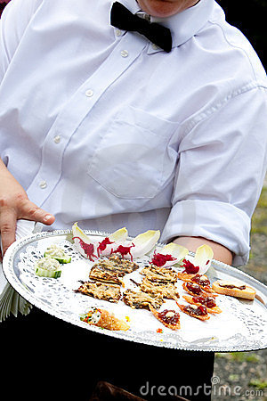 Waiter serving appetizers