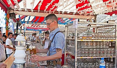 Waiter serving beer at the Oktoberfest Editorial Image