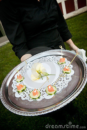 Waiter serving food during an event