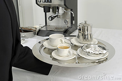 Waiter serving hot drinks on a tray Editorial Stock Photo