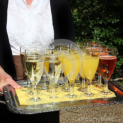 Waiter serving a tray of champagne