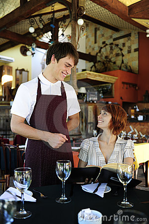 Free Waiter Talking To Costumer At The Restaurant Stock Photography - 14983482