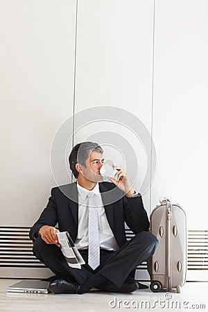Waiting: Business man drinking tea
