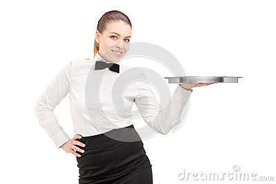 A waitress with bow tie holding an empty tray