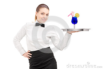 A waitress with bow tie holding a tray with cocktail on it tray