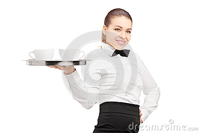 A waitress with bow tie holding a tray with coffee cups on it
