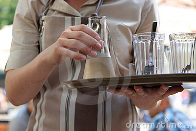 Waitress with decanter of liqueur