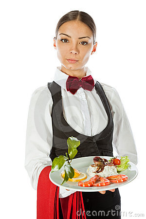 Young waitress standing and holding a dish with seafood salad ...