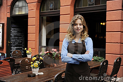 Waitress in front of restaurant