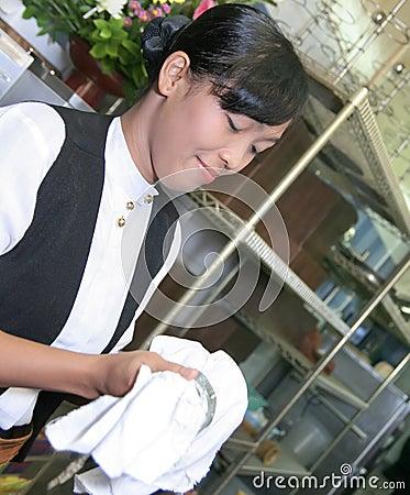 Waitress polishing glass