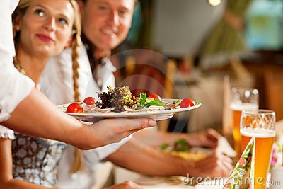 Waitress serving an Bavarian Restaurant