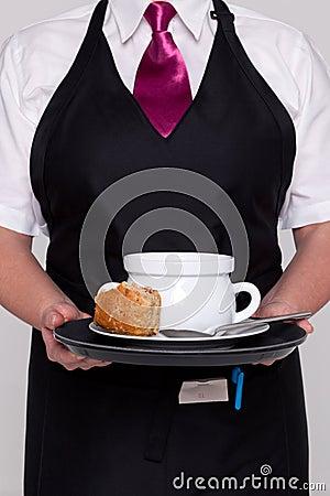 Waitress serving a bowl of soup
