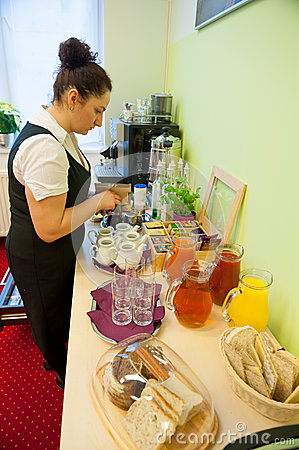 Waitress serving breakfast