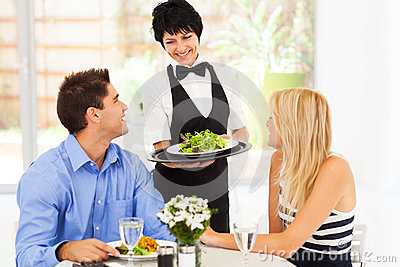 Waitress serving customers