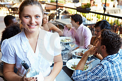 Waitress Serving Tables At Outdoor Restaurant
