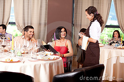 Waitress taking the order from restaurant table