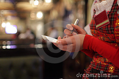 Waitress writing order