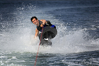Wakeboarder in water splash