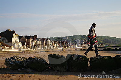 Walk on stones jetty in normandy