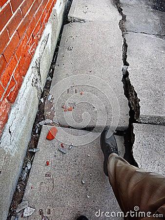 Walking on Broken Dangerous Sidewalk Stock Photo