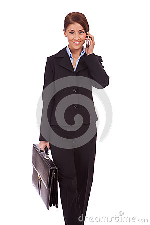 Walking business woman on the phone