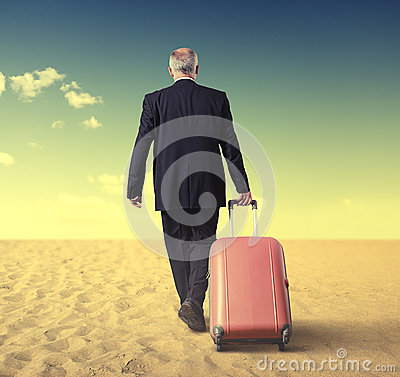 Free Walking Businessman With Suitcase In A Desert Stock Photo - 62098570