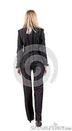 Walking businesswoman. back view