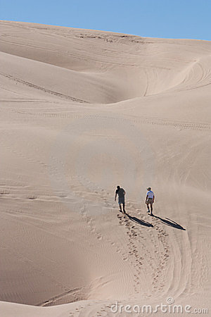 Walking through the desert Sand Dunes