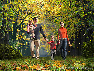 Walking family with children in autumnal park