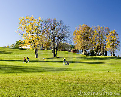 Walking Golfers In Autumn