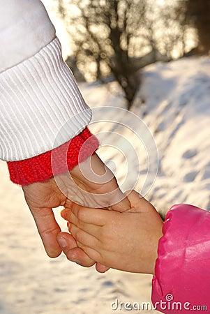 Walking hands together.
