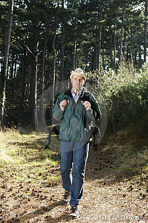 Walking hiker with backpack