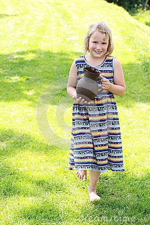 Walking little girl with pitcher