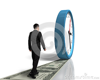 Walking on money way following rolling clock