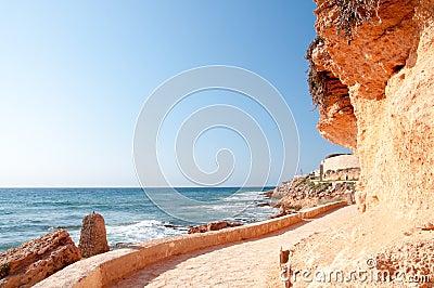 Walking path along rocky seashore.
