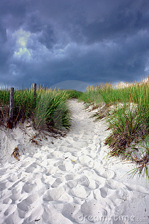 Walking Path over Sand Dune under Stormy Sky