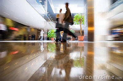 Walking people in modern business center