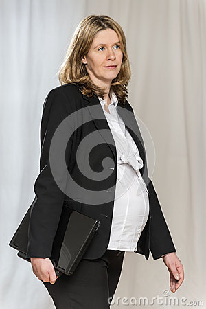 Walking pregnant business women