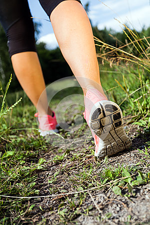 Walking or running legs in forest, summer activity