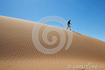 Walking on sand dune