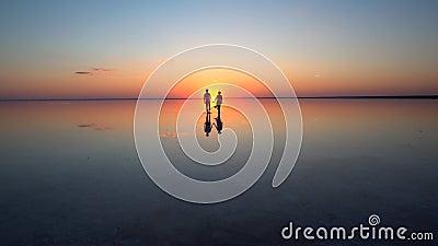 Walking into the setting sun Stock Photo